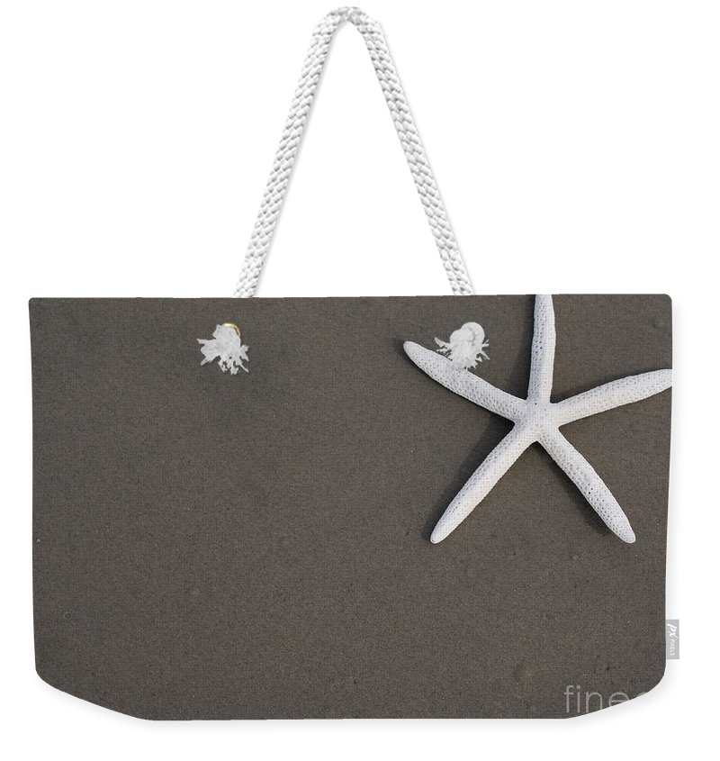 Seastar Weekender Tote Bag featuring the photograph White Starfish On Wet Sand Beach by Anthony Totah