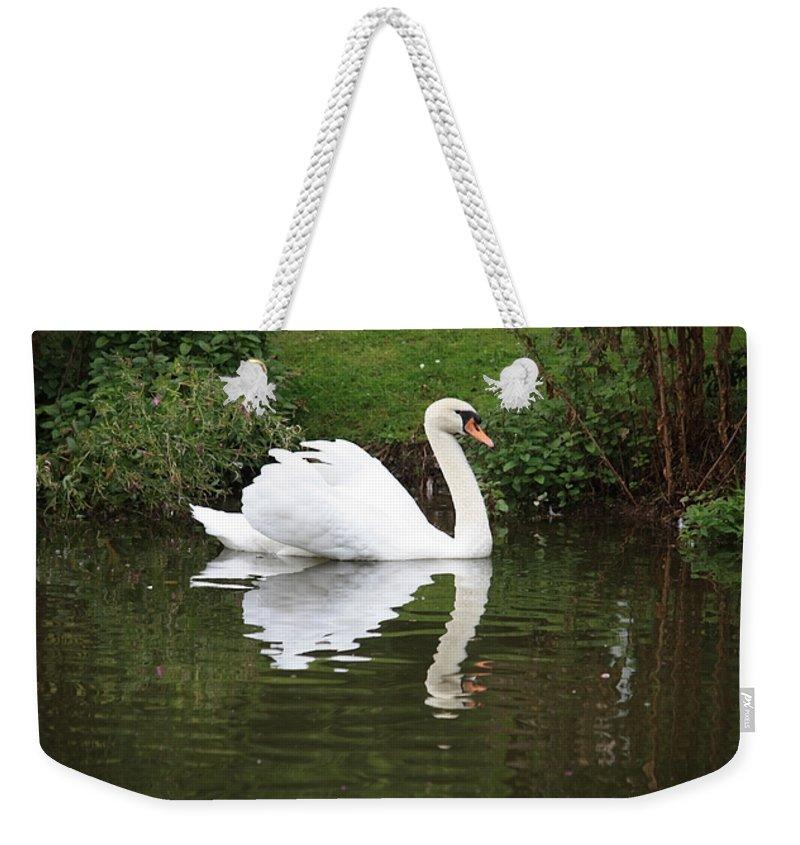 Swan Weekender Tote Bag featuring the photograph White Swan In Belgium Park by Carol Groenen
