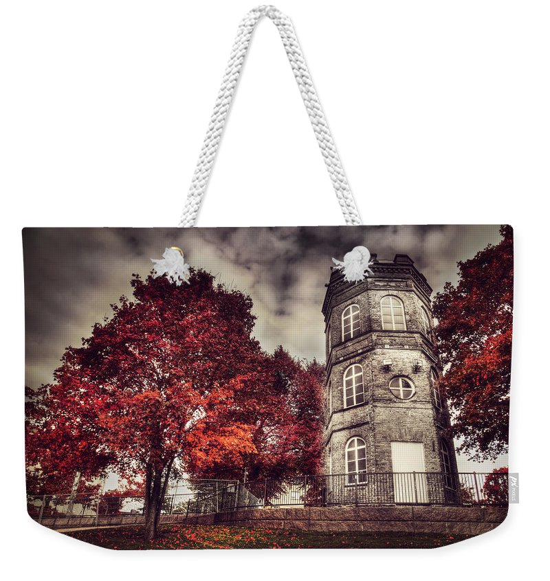 Red Weekender Tote Bag featuring the photograph White Tower Of Autumn by Sandra Rugina