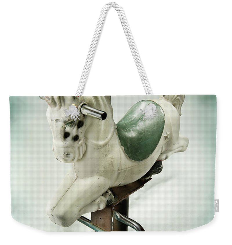 Playground Weekender Tote Bag featuring the photograph White Toy Horse by Yo Pedro