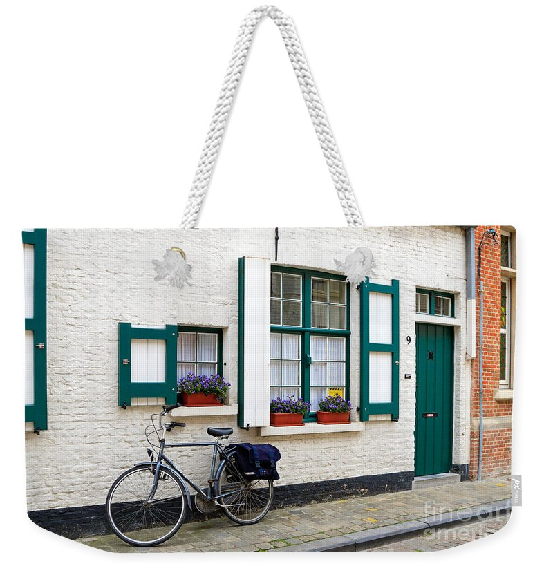 House Weekender Tote Bag featuring the photograph Whitewashed Brick House With Green Trimmed Shutters In Bruges by Louise Heusinkveld