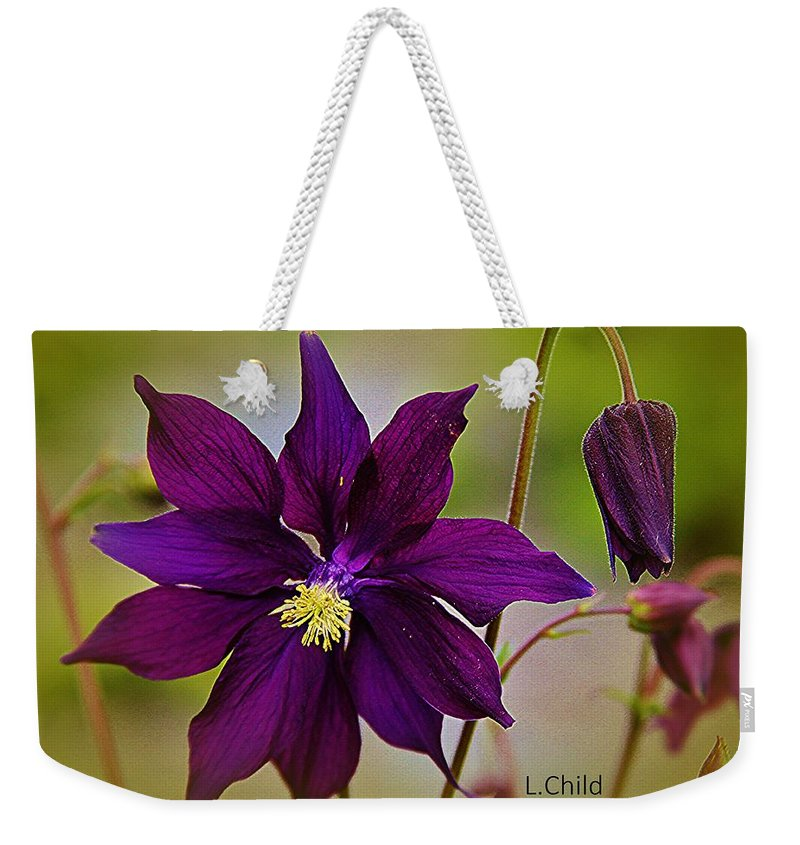 Purple Flower Weekender Tote Bag featuring the photograph Who Am I by Lori Mahaffey
