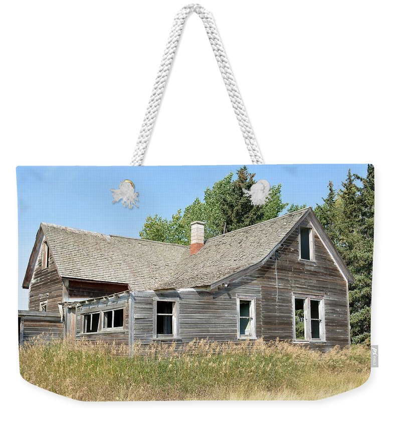House Weekender Tote Bag featuring the photograph Why Was I Left In The Tall Grass by Ed Mosier