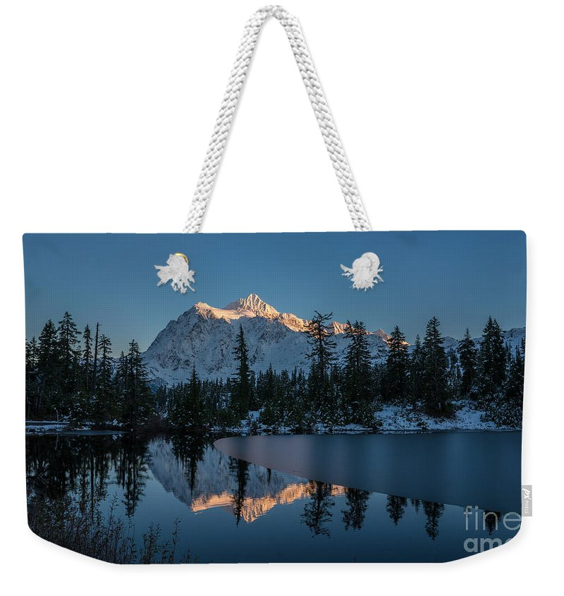 Shuksan Weekender Tote Bag featuring the photograph Wide Shuksans Last Light Reflected by Mike Reid