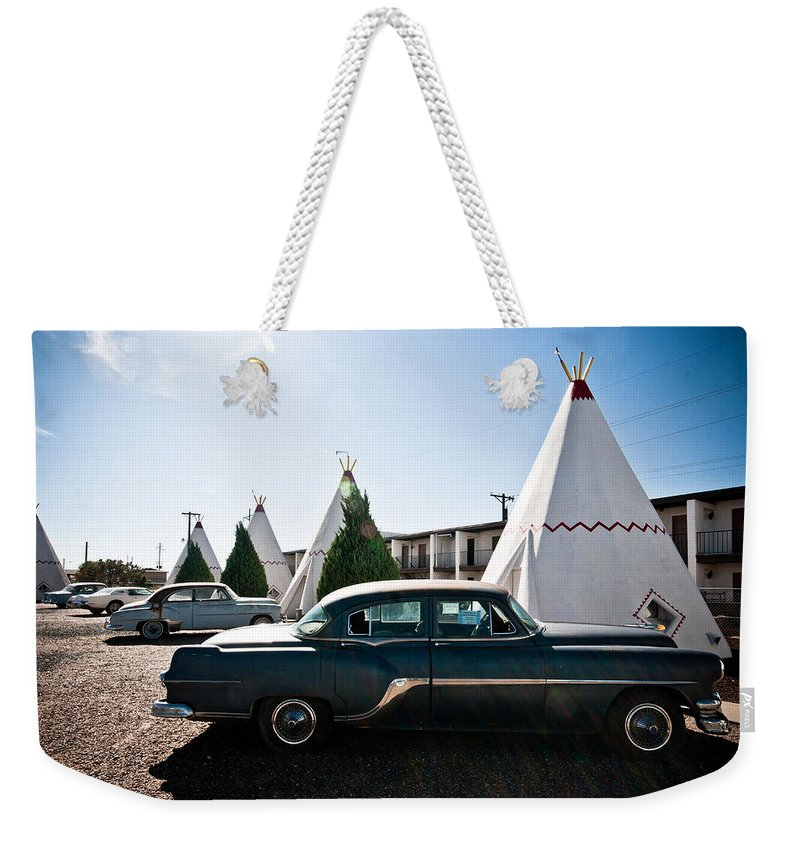 66 Weekender Tote Bag featuring the photograph Wigwam Motel Classic Car #5 by Robert J Caputo