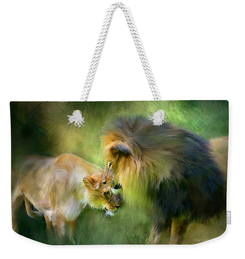 Lion Weekender Tote Bag featuring the mixed media Wild Instinct by Carol Cavalaris