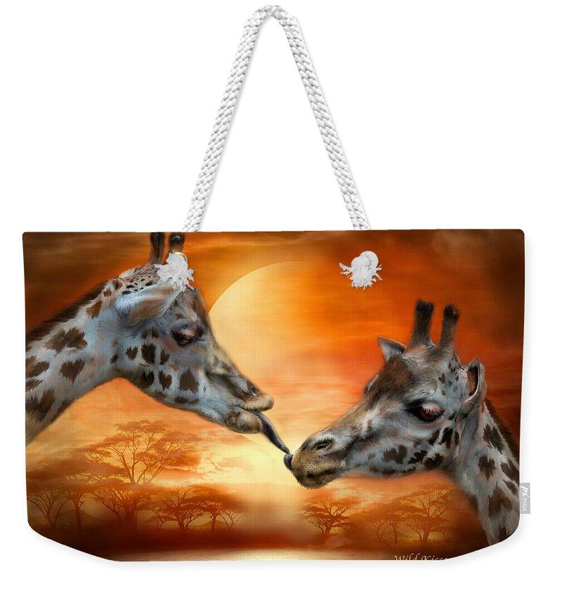 Giraffe Weekender Tote Bag featuring the mixed media Wild Kisses by Carol Cavalaris