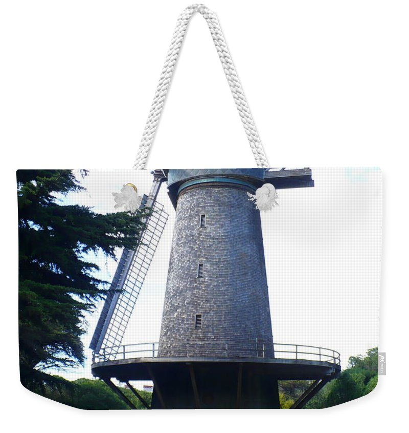 Windmill Weekender Tote Bag featuring the photograph Windmill In Golden Gate Park by Carol Groenen