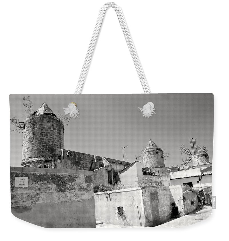 Windmills Weekender Tote Bag featuring the photograph Windmill Scrapyard by David Coleman