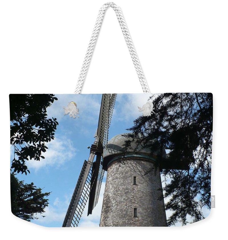 Windmill Weekender Tote Bag featuring the photograph Windmill Through The Trees by Carol Groenen