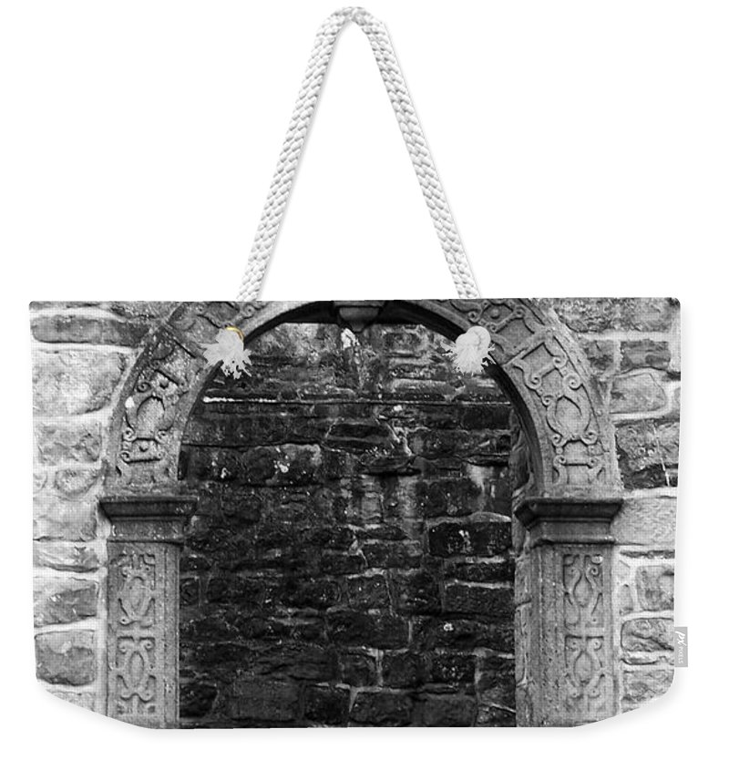 Irish Weekender Tote Bag featuring the photograph Window At Donegal Castle Ireland by Teresa Mucha