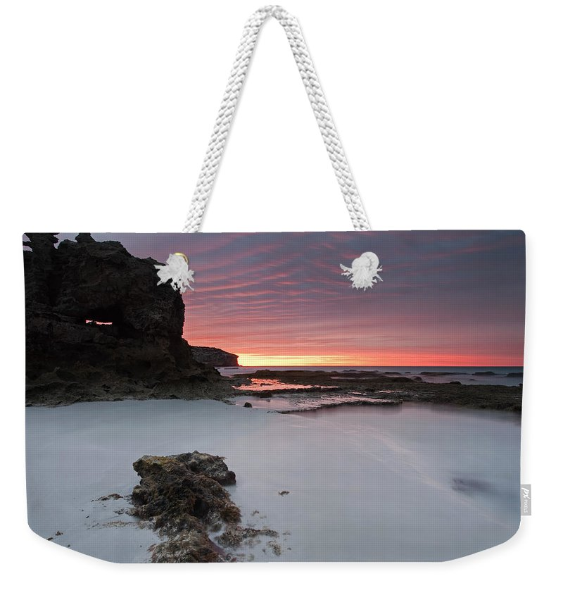 Sunrise Weekender Tote Bag featuring the photograph Window On Dawn by Mike Dawson