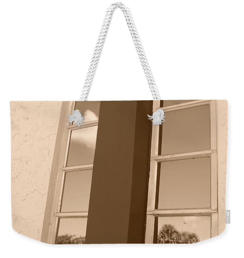 Sepia Weekender Tote Bag featuring the photograph Window T Glass by Rob Hans