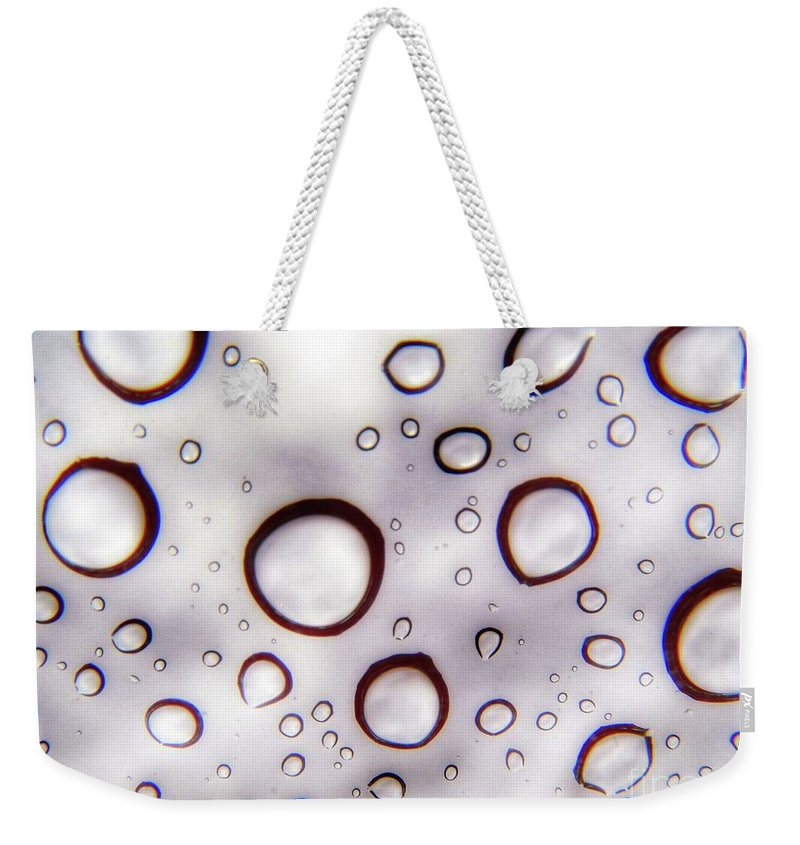 Raindrops Weekender Tote Bag featuring the photograph Window Waterdrops by John Myers