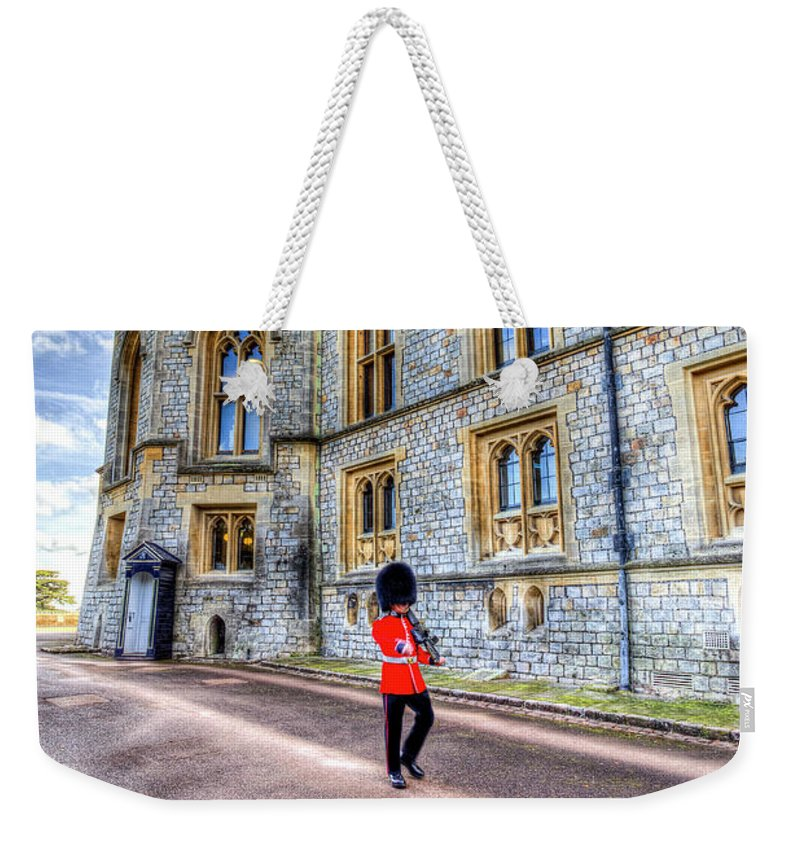 Windsor Castle Weekender Tote Bag featuring the photograph Windsor Castle And Coldstream Guard by David Pyatt