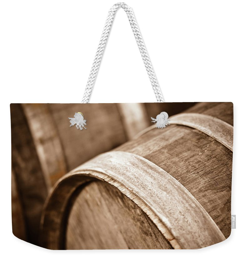 Beer Weekender Tote Bag featuring the photograph Wine Barrel In Cellar by Brandon Bourdages