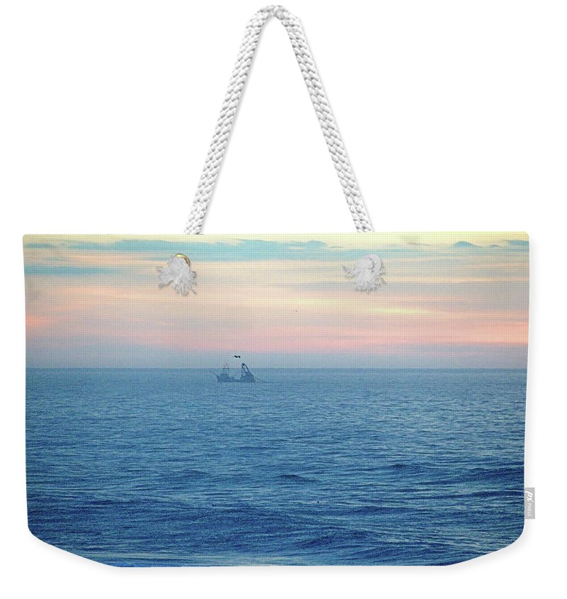 Fishing Weekender Tote Bag featuring the photograph Winter Dragger by Newwwman