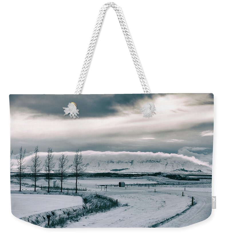 Iceland Weekender Tote Bag featuring the photograph Winter In Iceland by Jean-Claude Ardila
