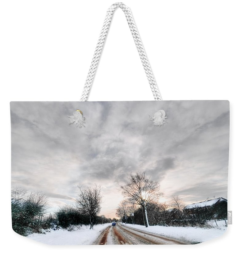 Winter Road Weekender Tote Bag featuring the photograph Winter Road by Svetlana Sewell