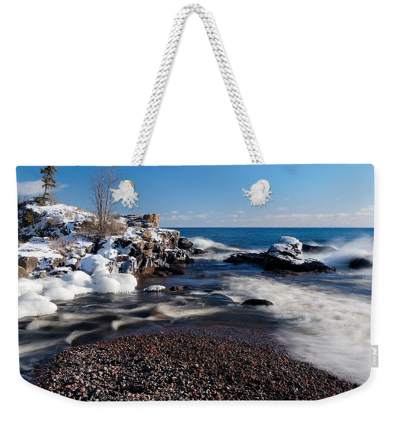 Michigan Weekender Tote Bag featuring the photograph Winter Splash by Sebastian Musial
