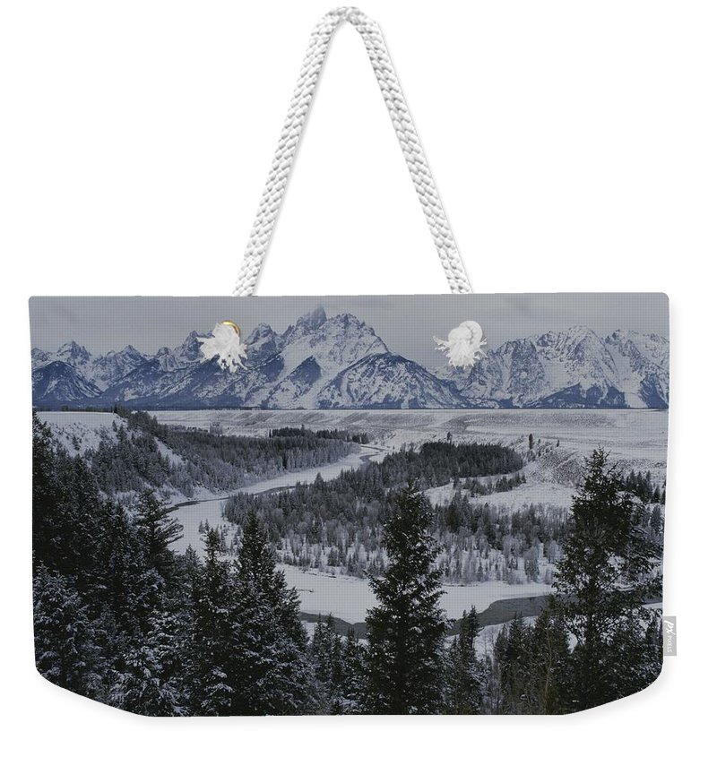 North America Weekender Tote Bag featuring the photograph Winter View Of The Snake River, Grand by Raymond Gehman