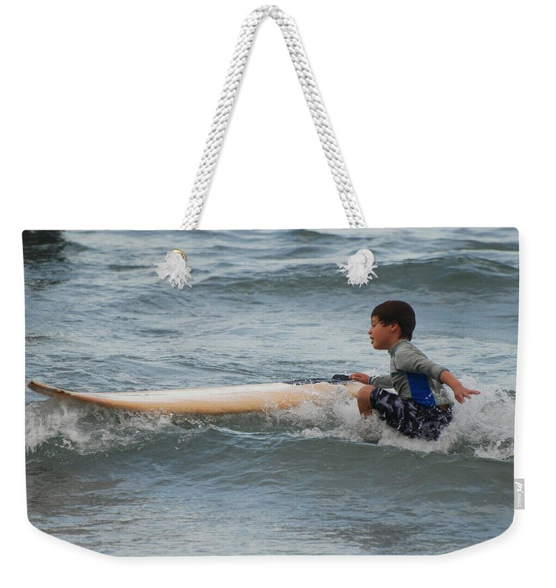 Beach Weekender Tote Bag featuring the photograph Wipe Out by Rob Hans