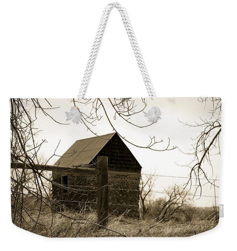 Rock Weekender Tote Bag featuring the photograph Wistful by Marilyn Hunt