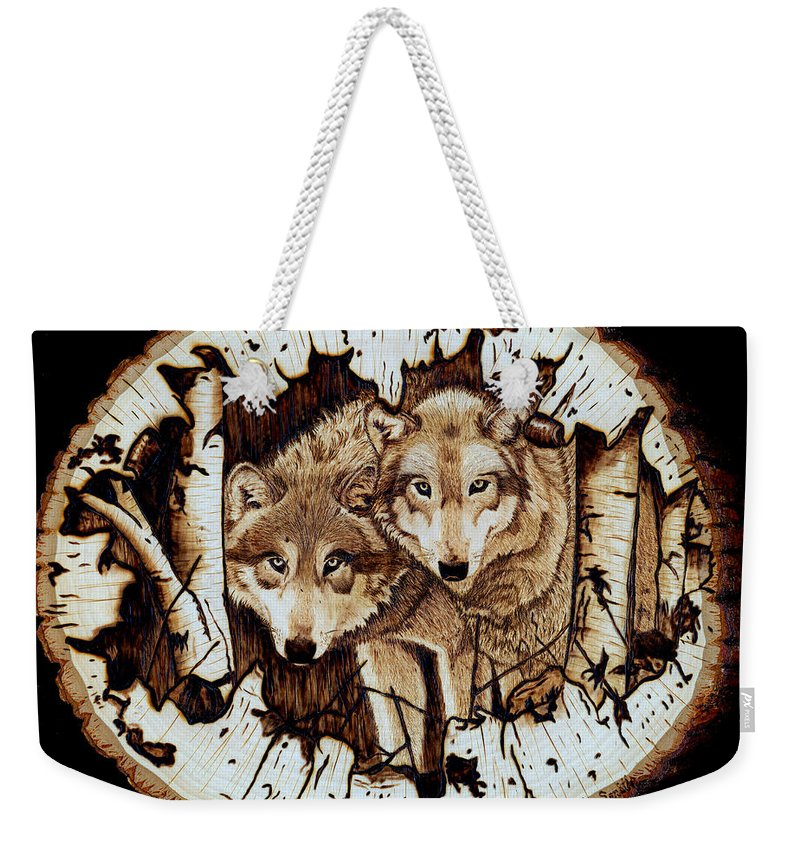 Wolves Weekender Tote Bag featuring the pyrography Wolves In Hiding by Danette Smith