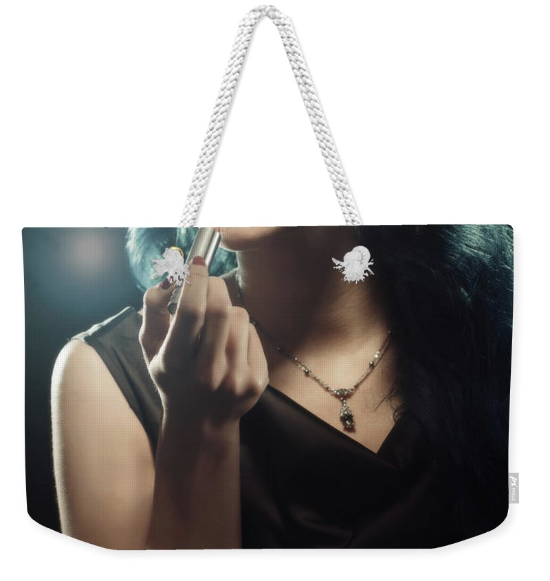 Hollywood Weekender Tote Bag featuring the photograph Woman Applying Lipstick by Amanda Elwell