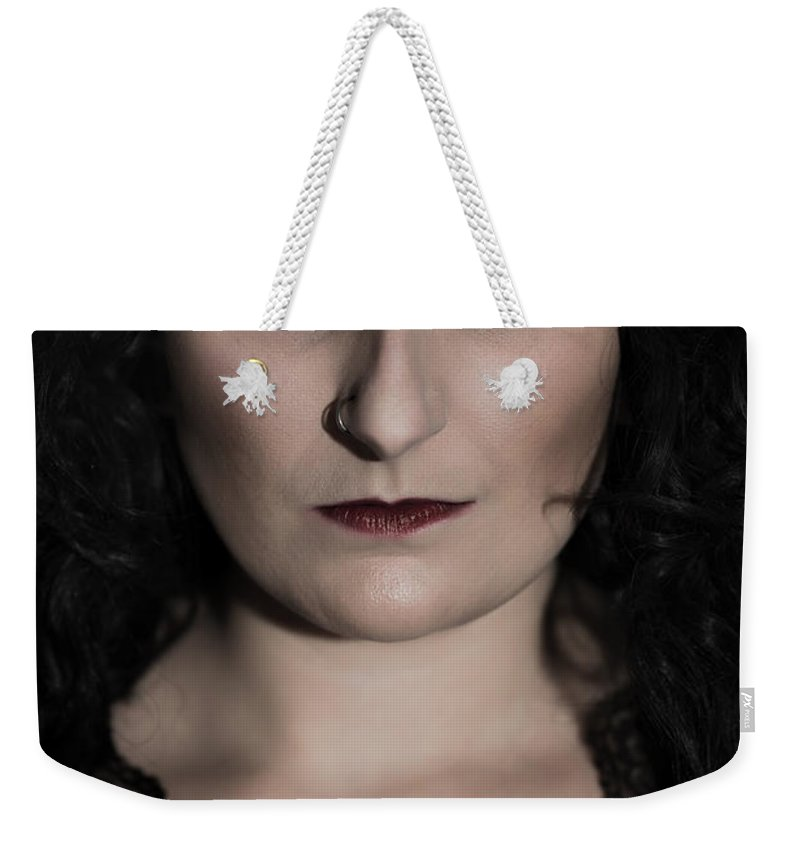 Gothic Weekender Tote Bag featuring the photograph Woman In Black by Amanda Elwell