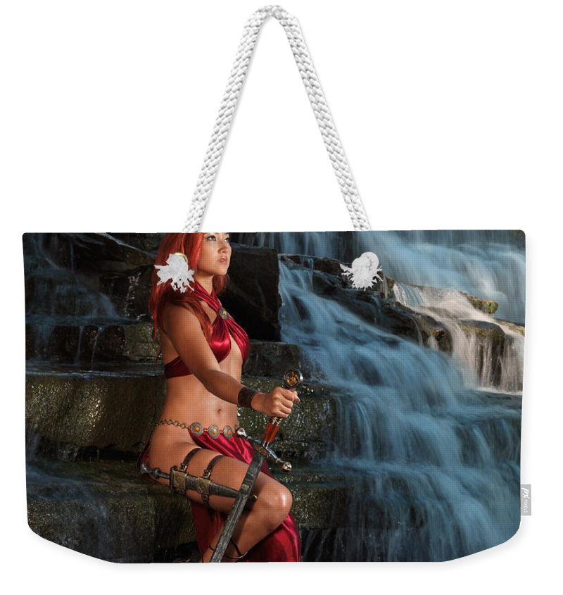 Woman Weekender Tote Bag featuring the photograph Woman Warrior by Oleksiy Maksymenko