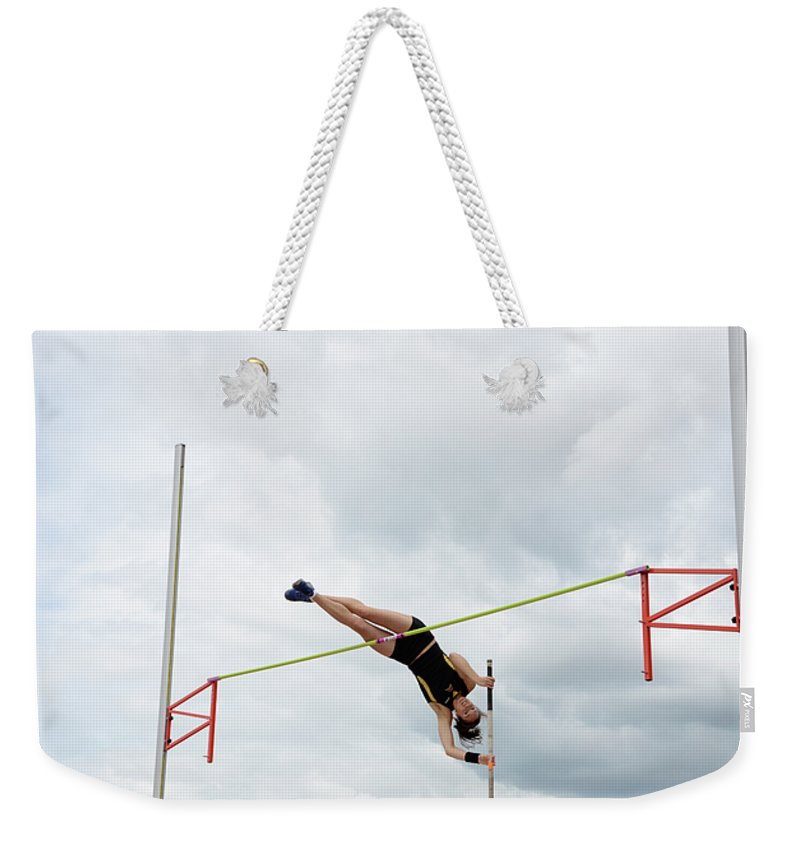 Canadian Track And Field National Championships 2011 Weekender Tote Bag featuring the photograph Womens Pole Vault 3 by Bob Christopher