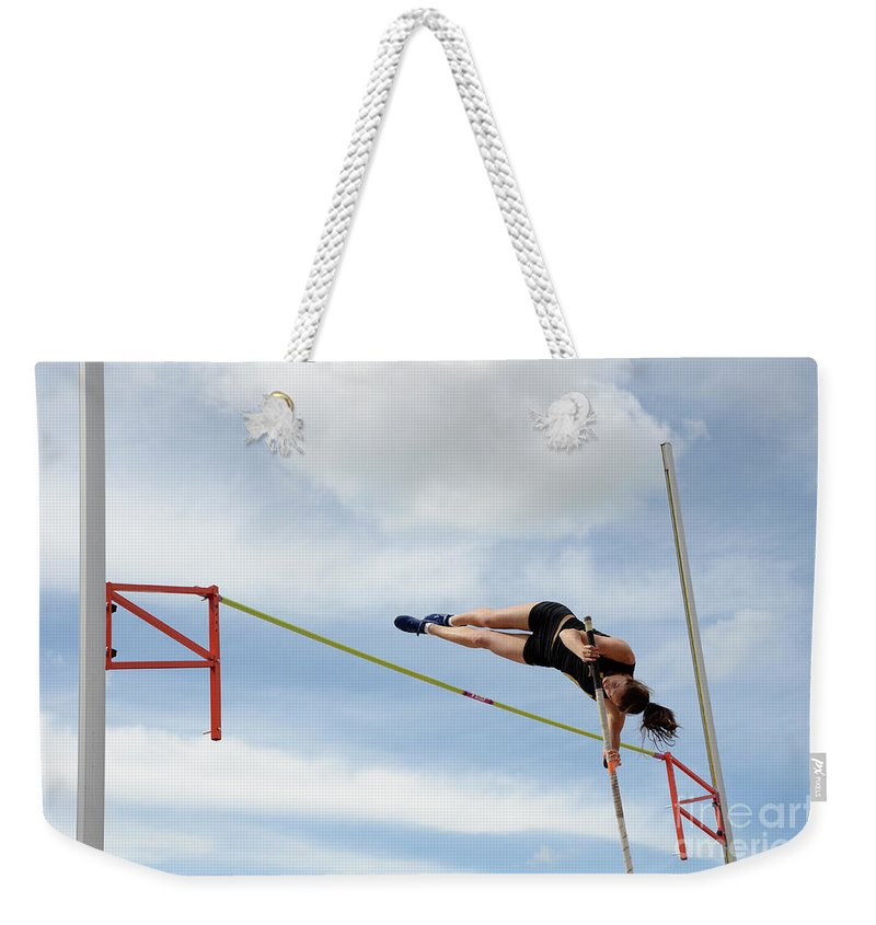 Canadian Track And Field National Championships 2011 Weekender Tote Bag featuring the photograph Womens Pole Vault by Bob Christopher