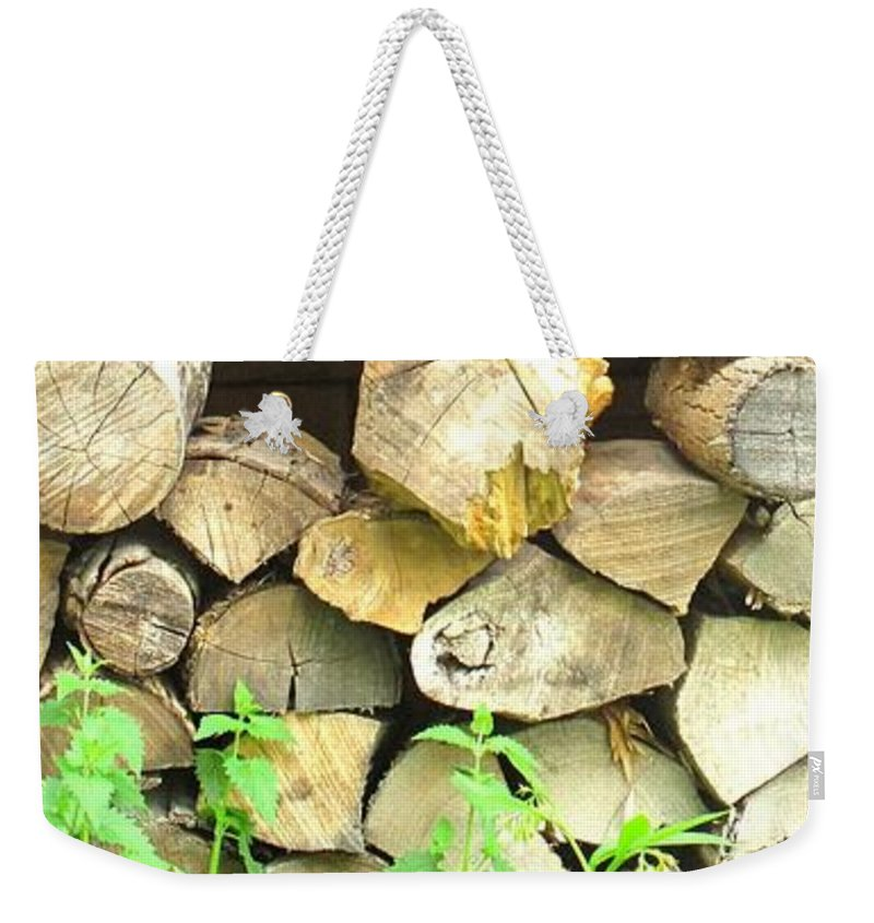 Wood Weekender Tote Bag featuring the photograph Wood Pile by Ian MacDonald