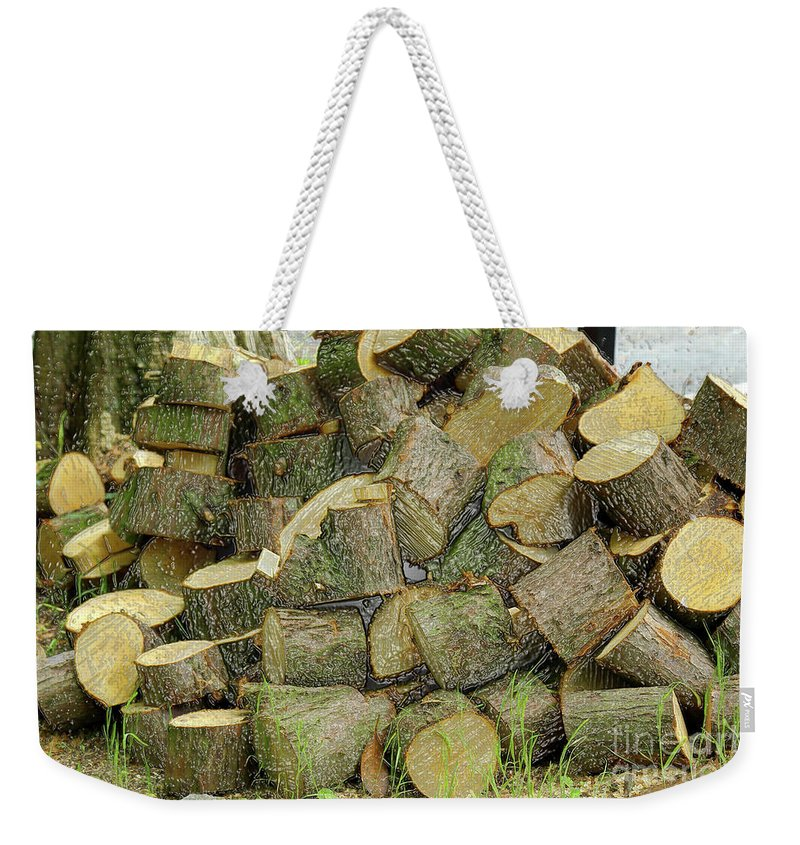 Wood Pile Weekender Tote Bag featuring the photograph Wood Pile by Kevin Richardson
