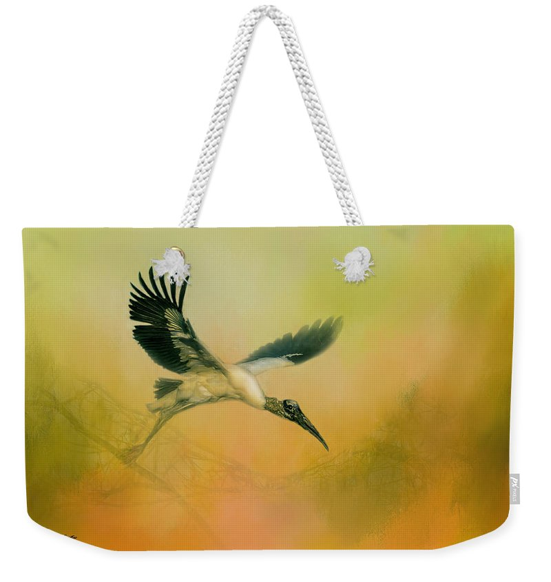 Birds Weekender Tote Bag featuring the photograph Wood Stork Encounter by Marvin Spates
