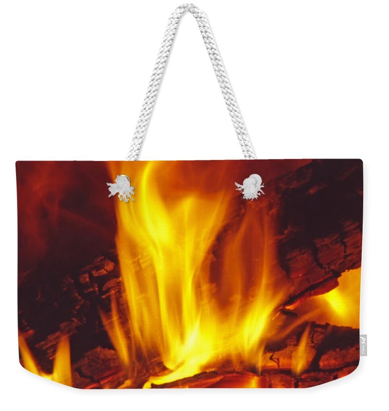 Fire Weekender Tote Bag featuring the photograph Wood Stove - Blazing Log Fire by Steve Ohlsen