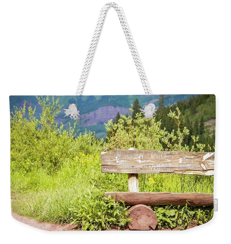 Bench Weekender Tote Bag featuring the photograph Wooden Bench by Livia Pavelescu