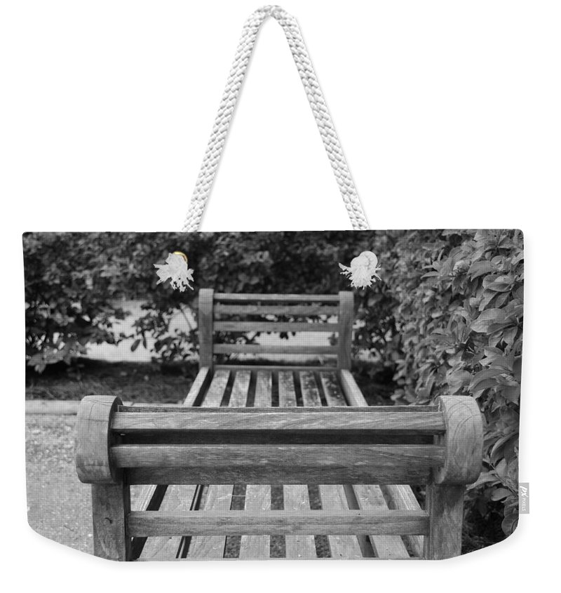Bushes Weekender Tote Bag featuring the photograph Wooden Bench by Rob Hans