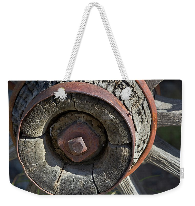 Wheel Weekender Tote Bag featuring the photograph Wooden Hub by Phyllis Denton