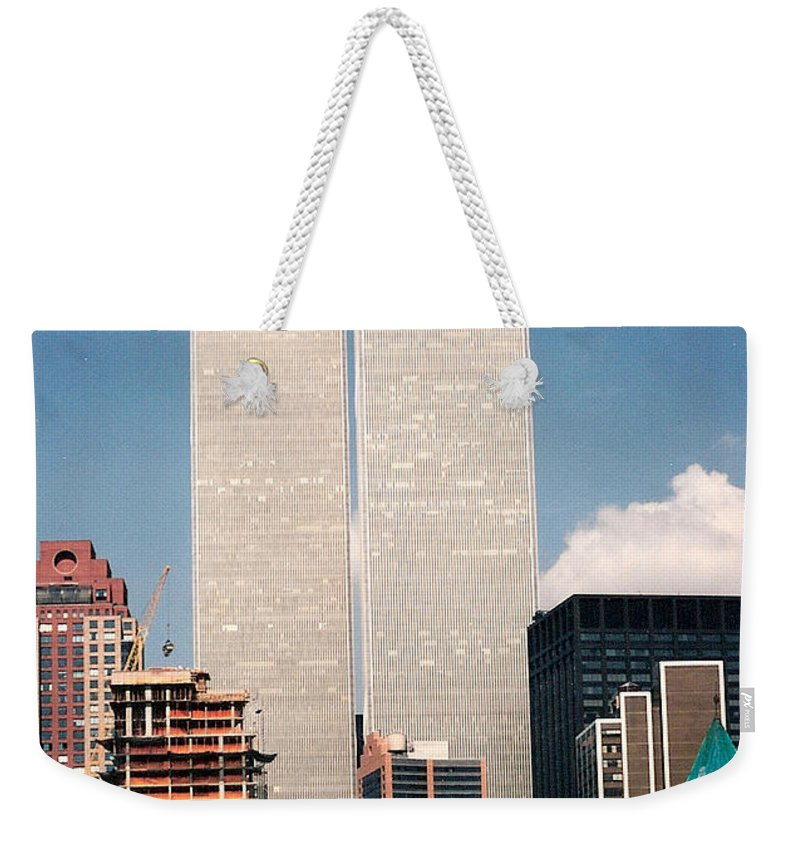 World Trade Center Weekender Tote Bag featuring the photograph World Trade Center 1990 by Lauri Novak