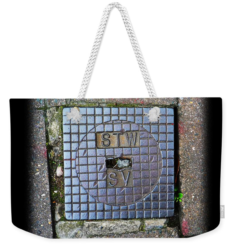 Cast Iron Weekender Tote Bag featuring the photograph World View by Charles Stuart