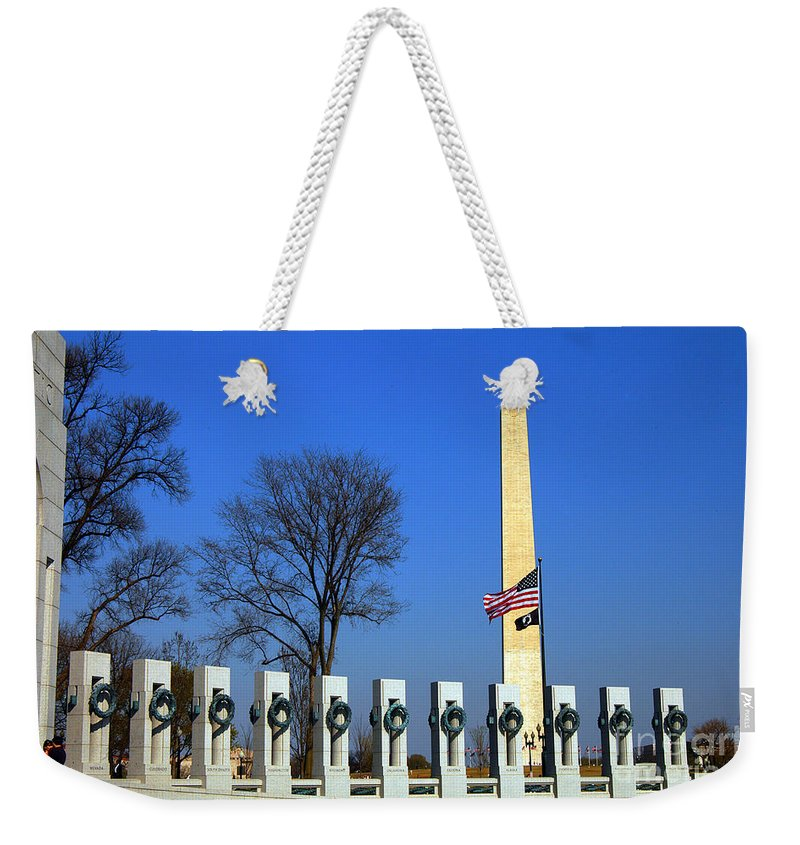 Clay Weekender Tote Bag featuring the photograph World War II Memorial And Washington Monument by Clayton Bruster