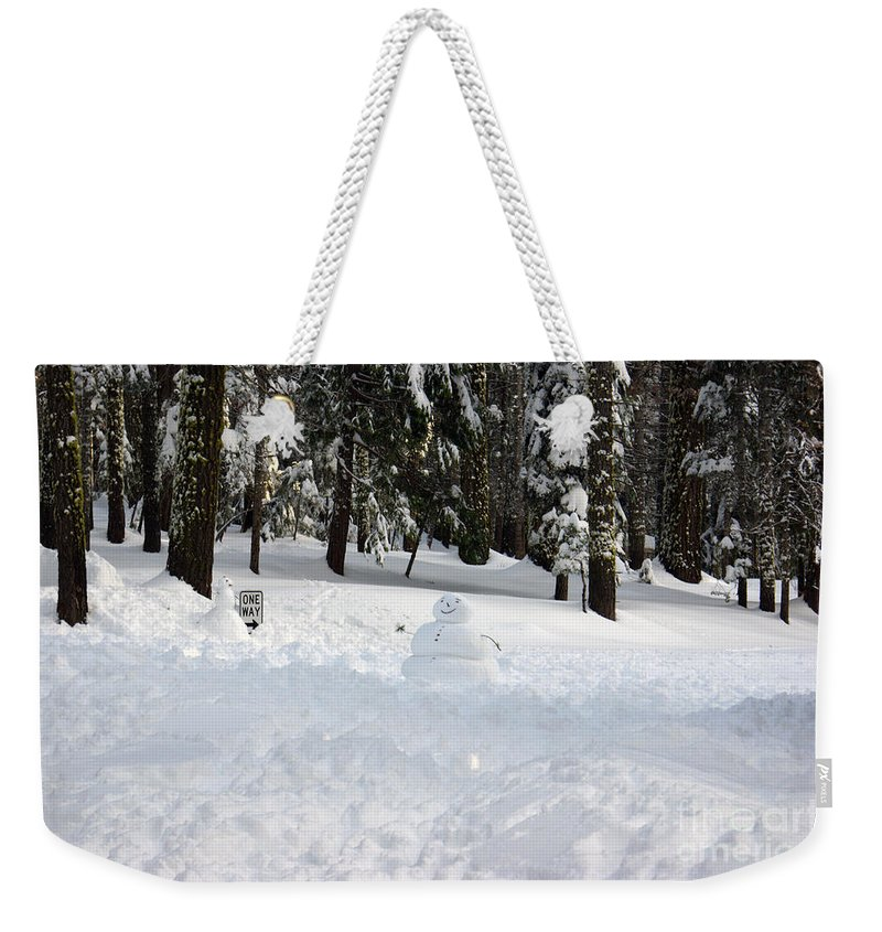Snowman Weekender Tote Bag featuring the photograph Wrong Way Snowman by Christine Jepsen