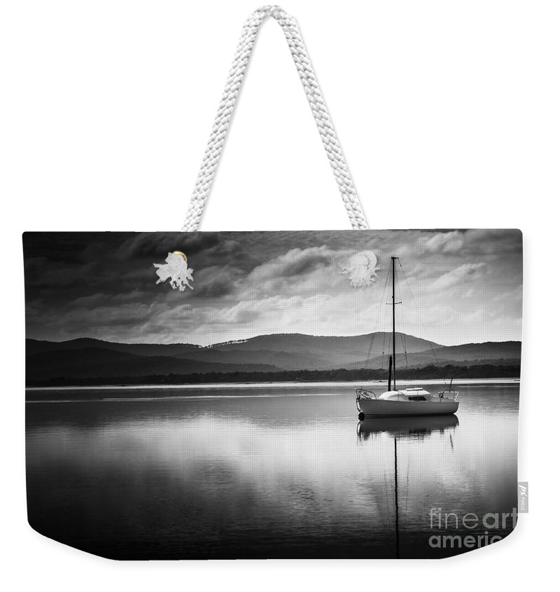Nautical Weekender Tote Bag featuring the photograph Yacht Sailing Boat With Sails Down In Port Sorell by Jorgo Photography - Wall Art Gallery