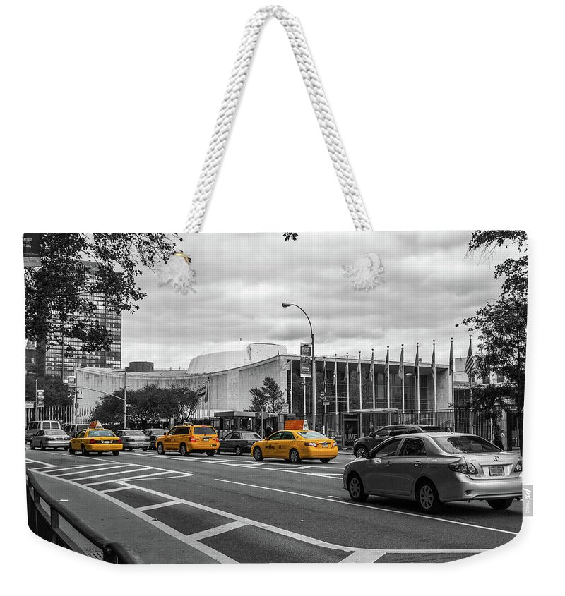 Big Apple Weekender Tote Bag featuring the photograph Yellow Cabs By The United Nations, New York 2 by Art Calapatia
