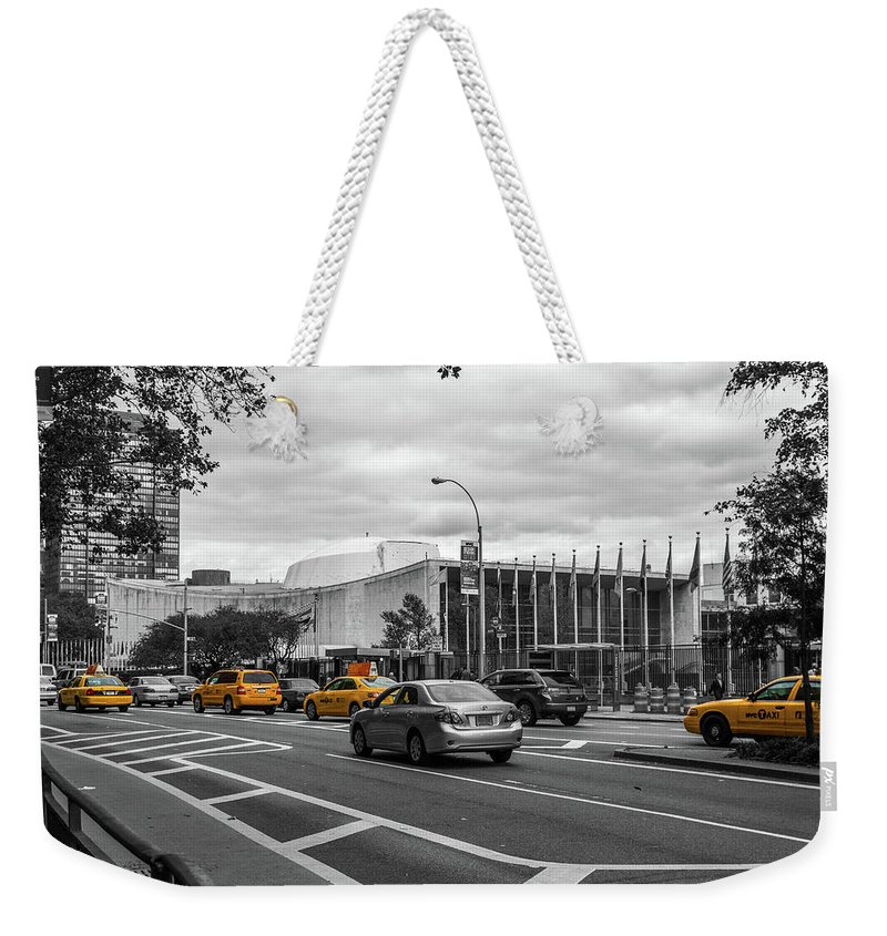Big Apple Weekender Tote Bag featuring the photograph Yellow Cabs By The United Nations, New York 3 by Art Calapatia