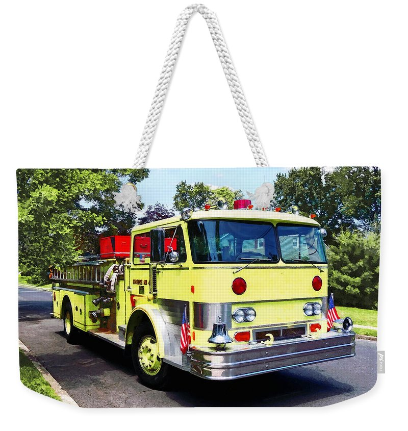 Fire Engine Weekender Tote Bag featuring the photograph Yellow Fire Truck by Susan Savad