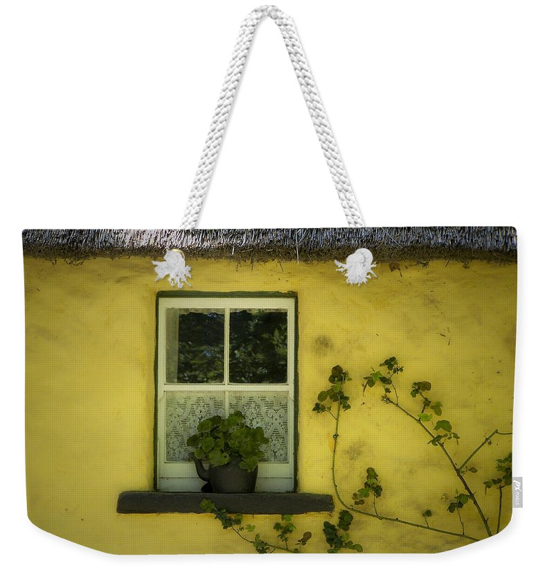 Irish Weekender Tote Bag featuring the photograph Yellow House County Clare Ireland by Teresa Mucha