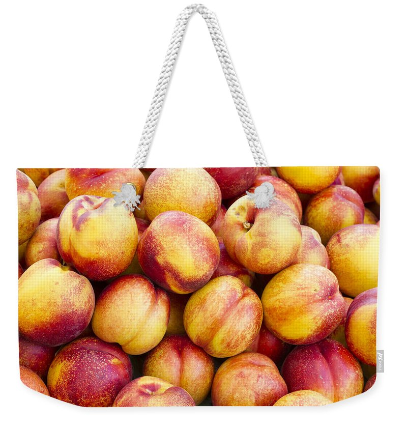 Fruit Weekender Tote Bag featuring the photograph Yellow Nectarines by John Trax